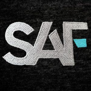 SAF Mens Polo CYAN Logo Close Up